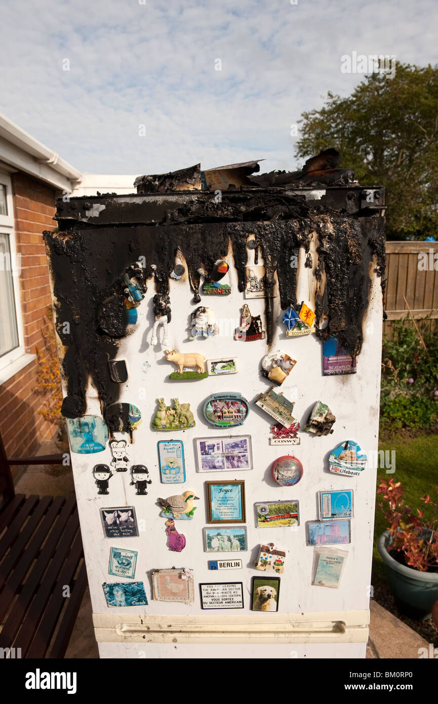 Domestic Fridge Freezer fire electrical fault - Stock Image