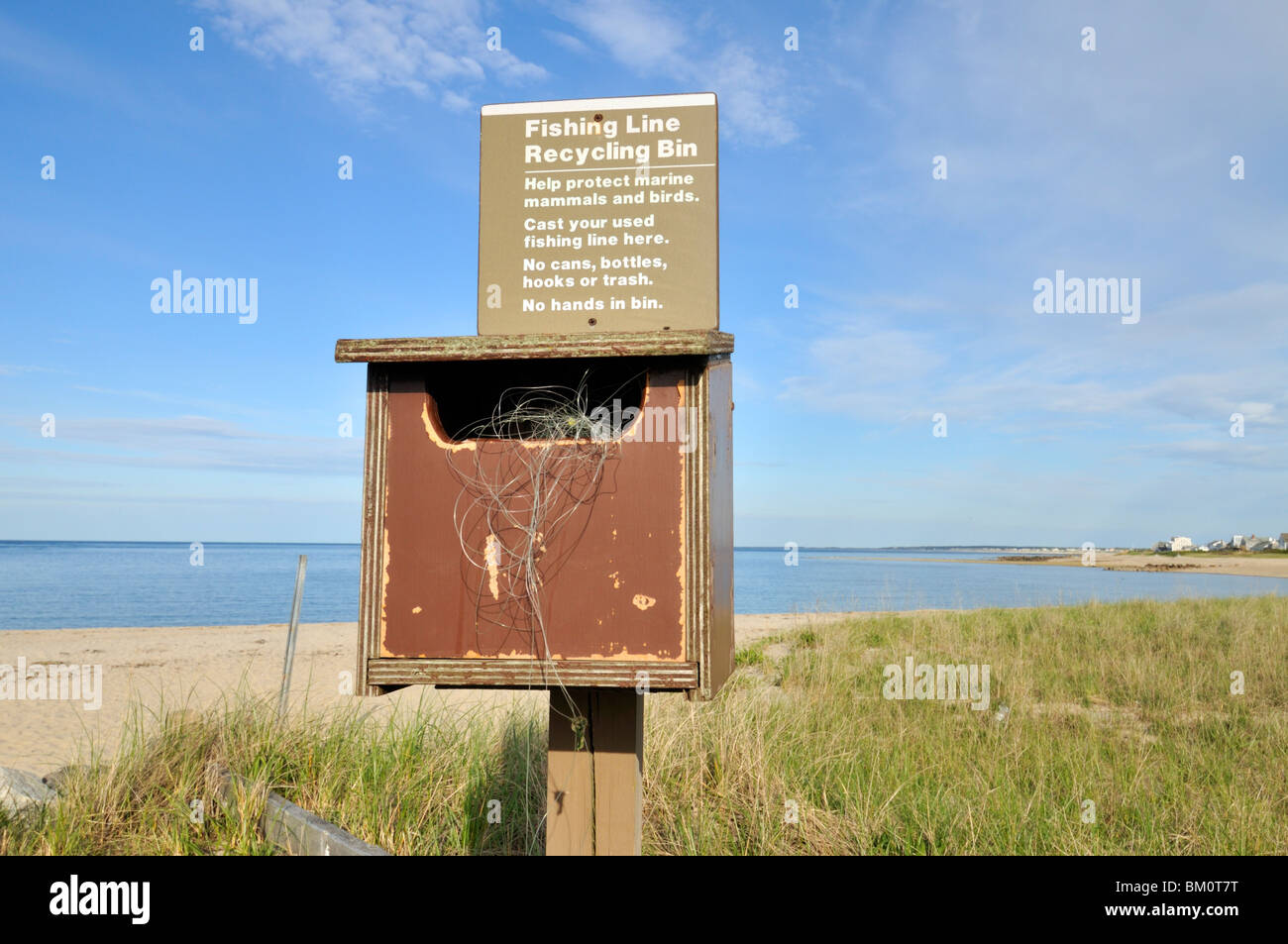 Fishing line recycling bin on shoreline at beach in Sandwich, Cape Cod Bay USA - Stock Image