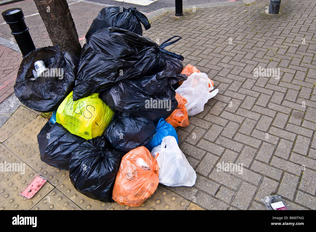 Pile of rubbish bags in residential area - Stock Image