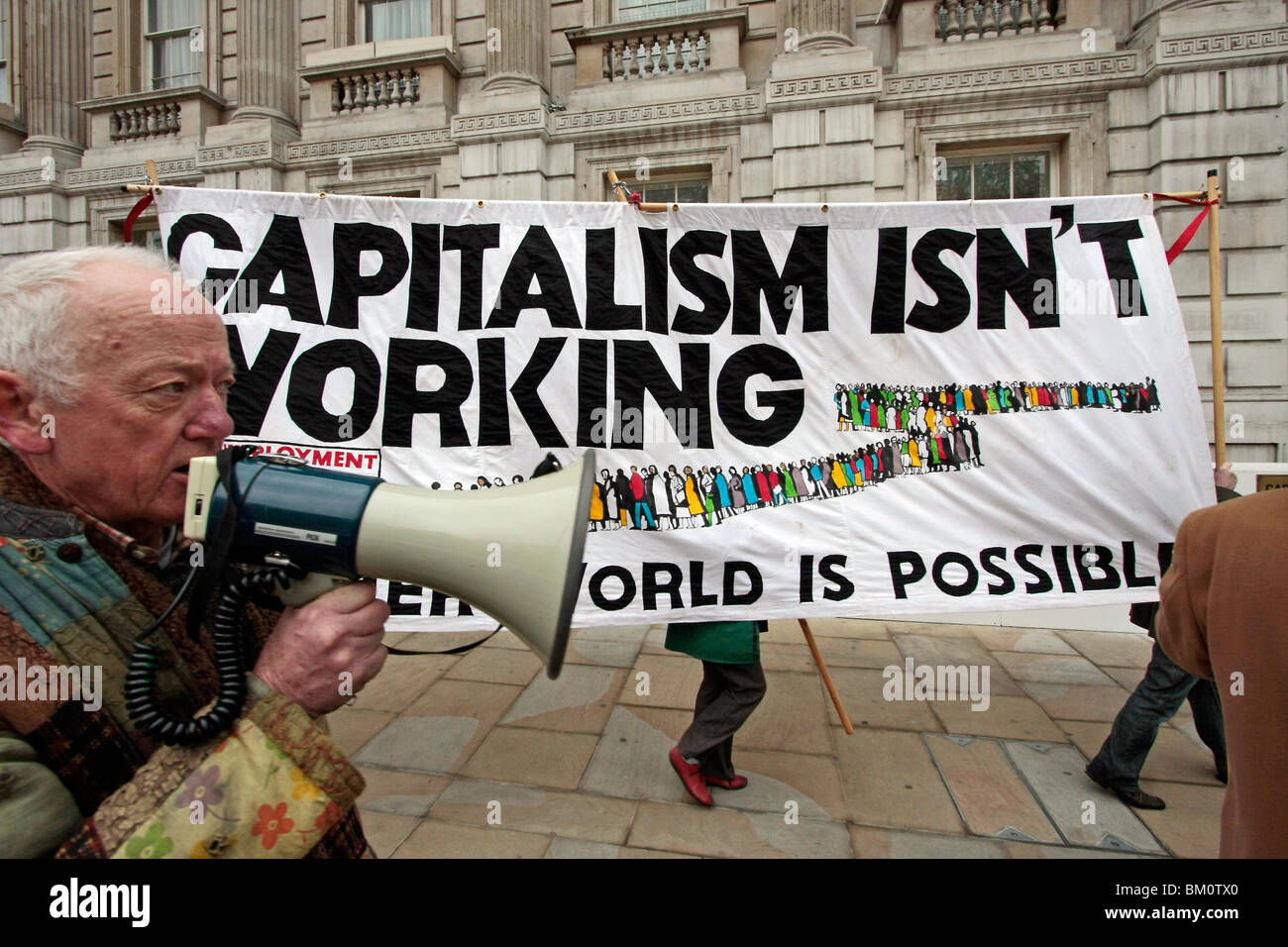 An anti-capitalist demo with a large banner in central London - Stock Image