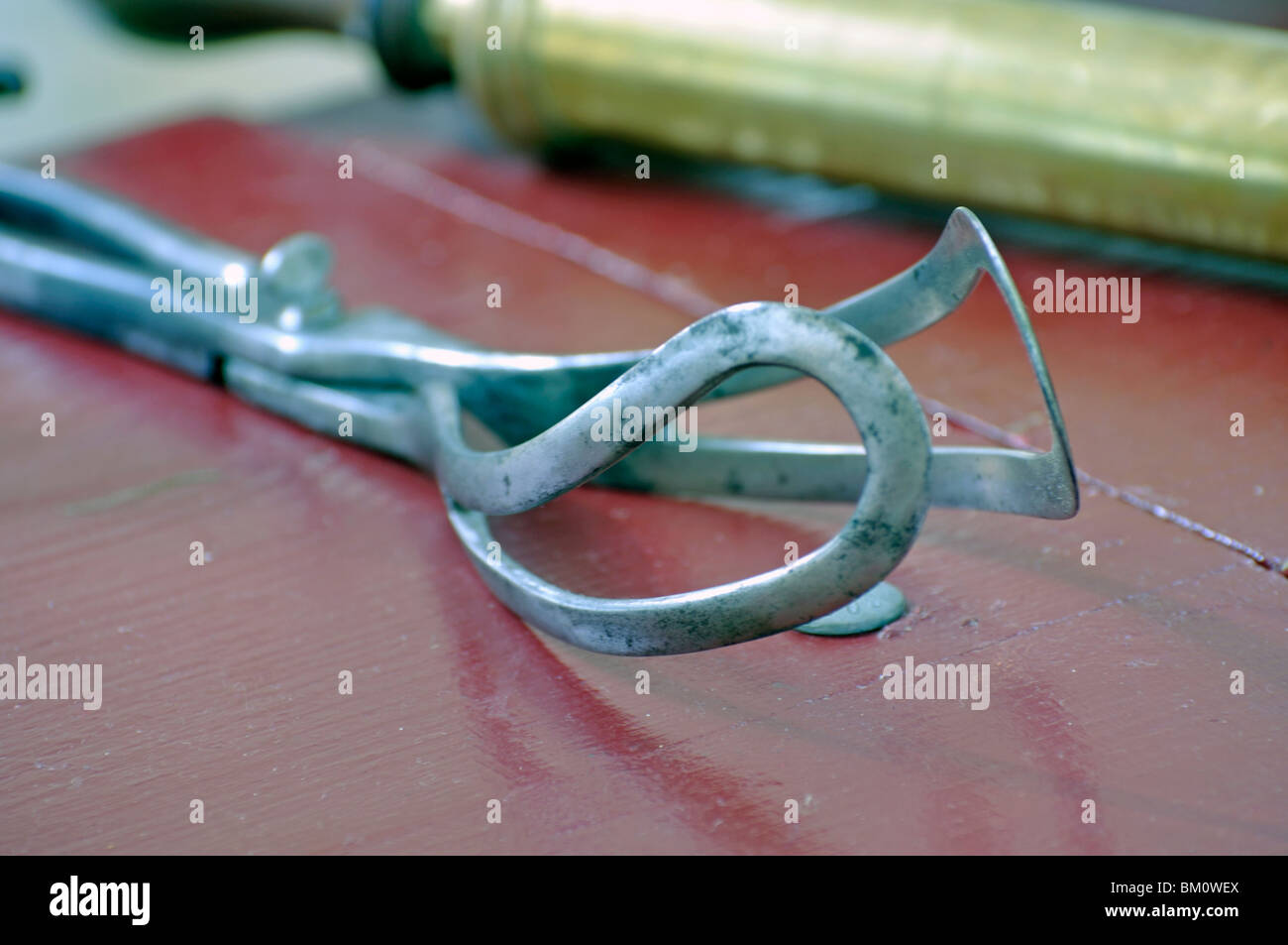 Forceps, old birthing medical instrument used during labor to help remove the fetus from the birth canal - Stock Image