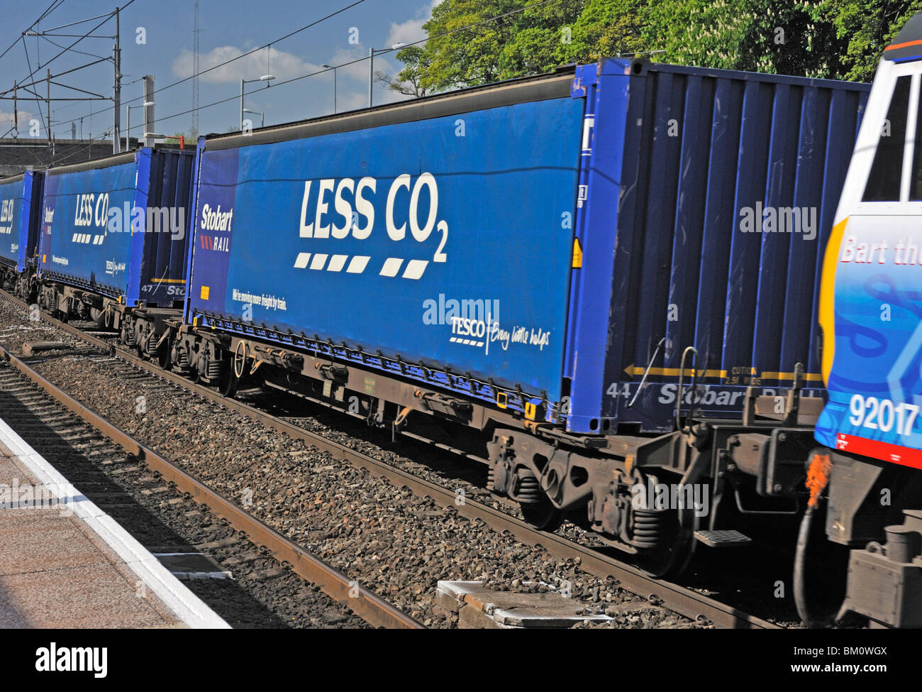 "Stobart Rail locomotive No. 92017 ""Bart the Engine"" hauling Tesco Less CO2 freight. West Coast Main Line. Oxenholme, Stock Photo"