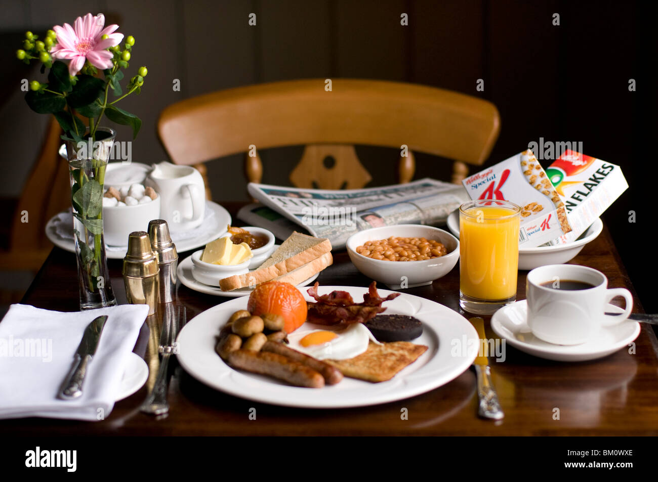 classic english breakfast table with orange juice and coffee and newspaper & classic english breakfast table with orange juice and coffee and ...