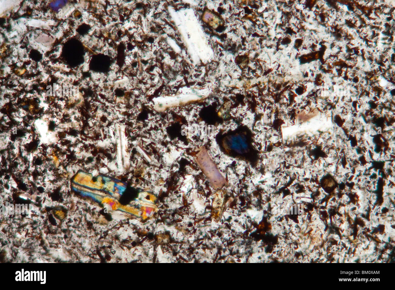 Photomicrograph of Andesite from Montserrat, the Soufriere volcano. - Stock Image