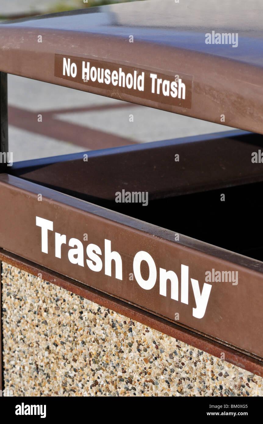 Trash barrel labeled Trash Only, No Household Trash - Stock Image