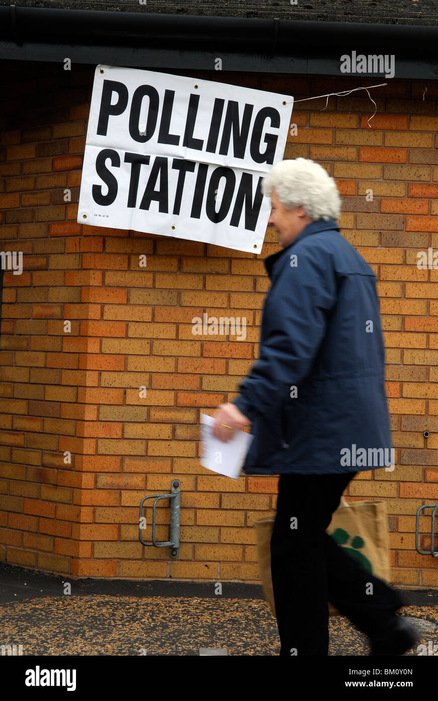 Elderly woman en route to polling station to cast her vote in May 2010 general election in UK, Bordon, Hampshire, - Stock Image