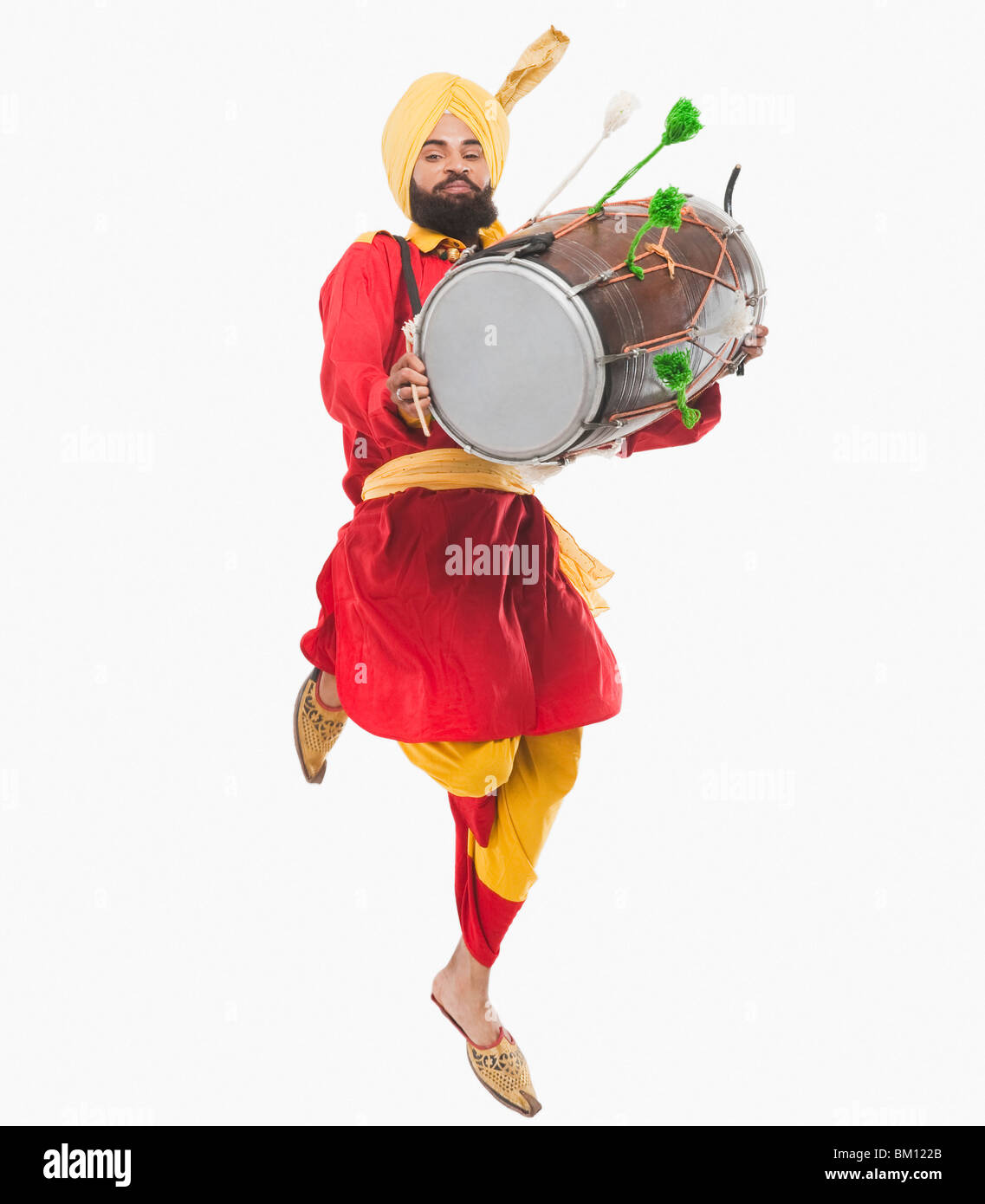 Man Performing Bhangra Dance With A Dholak