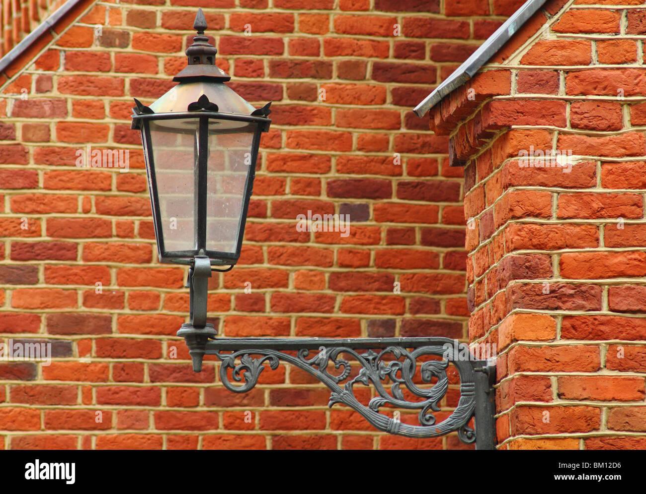 Old Gaslight Street Lamp Against Gothic Brick Wall Wroclaw Ostrow Tumski Poland