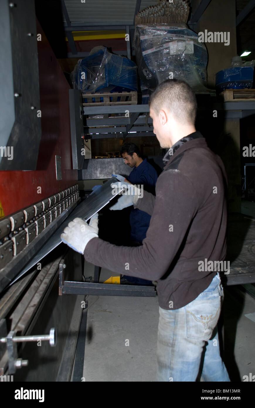 Kurdish and Irak worker binding in a steel factory lebanon - Stock Image