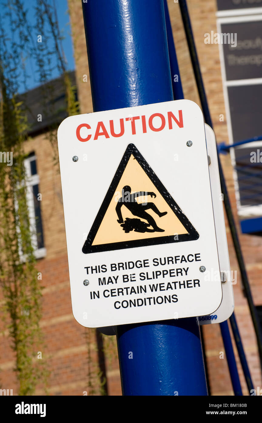 Caution sign on a pedestrian bridge in England - Stock Image