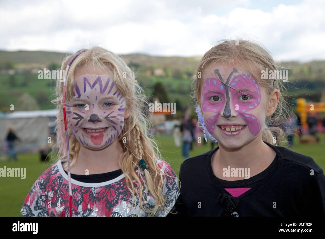 Two girls with painted faces Mayday at Woodmancote Cheltenham UK 2010 - Stock Image