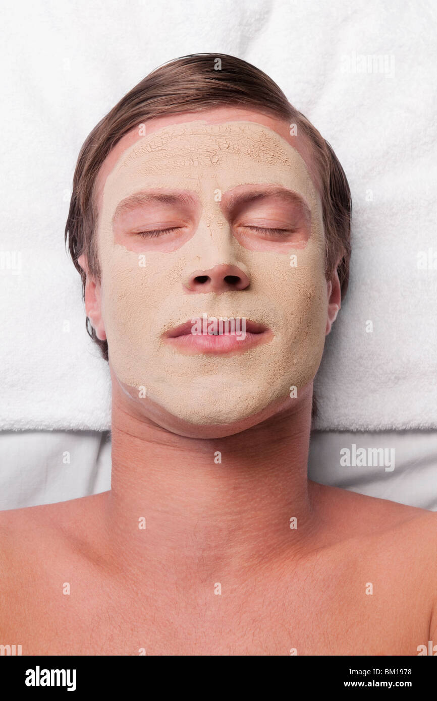 Man with face pack on his face - Stock Image