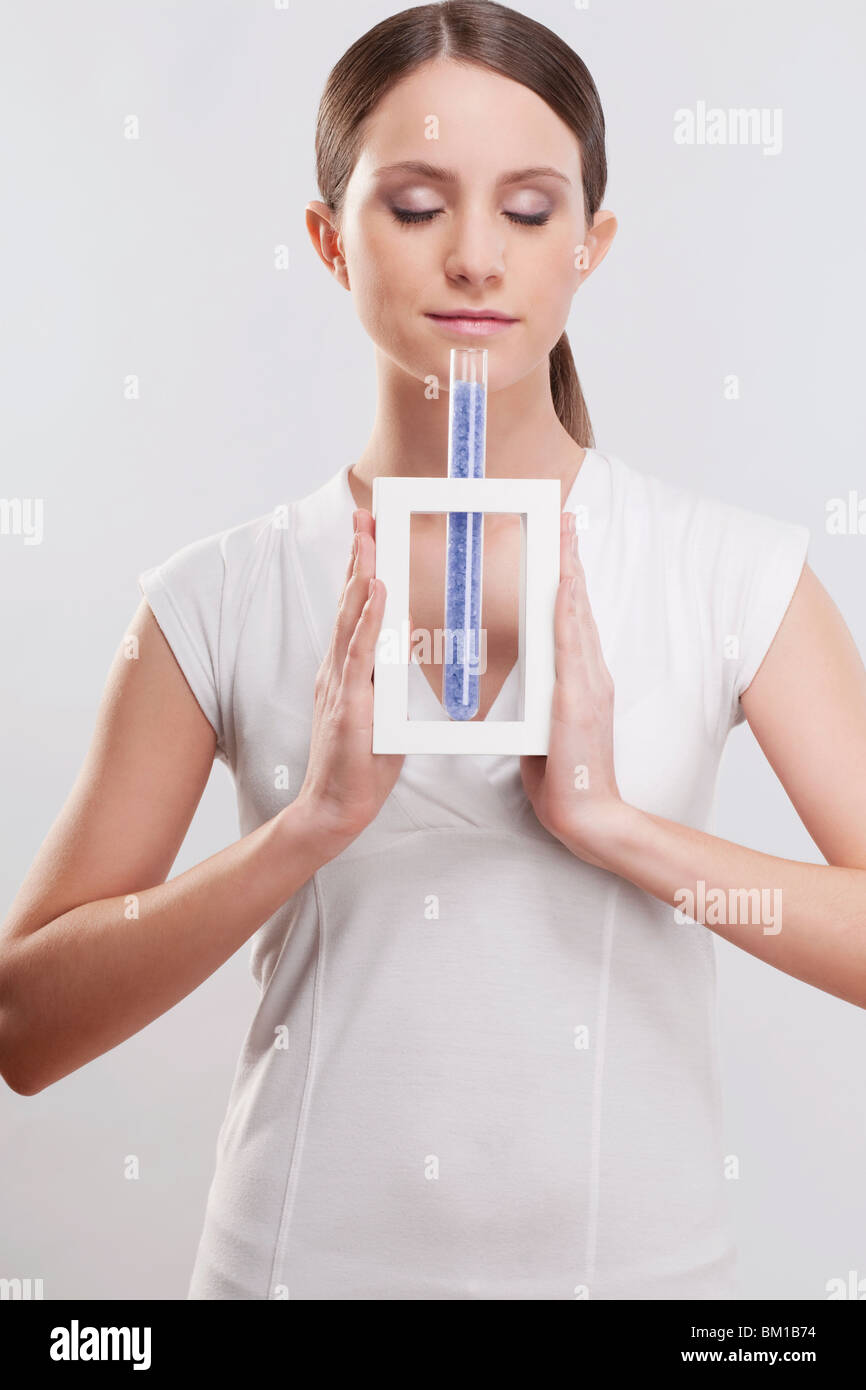 Woman smelling bath crystals Stock Photo