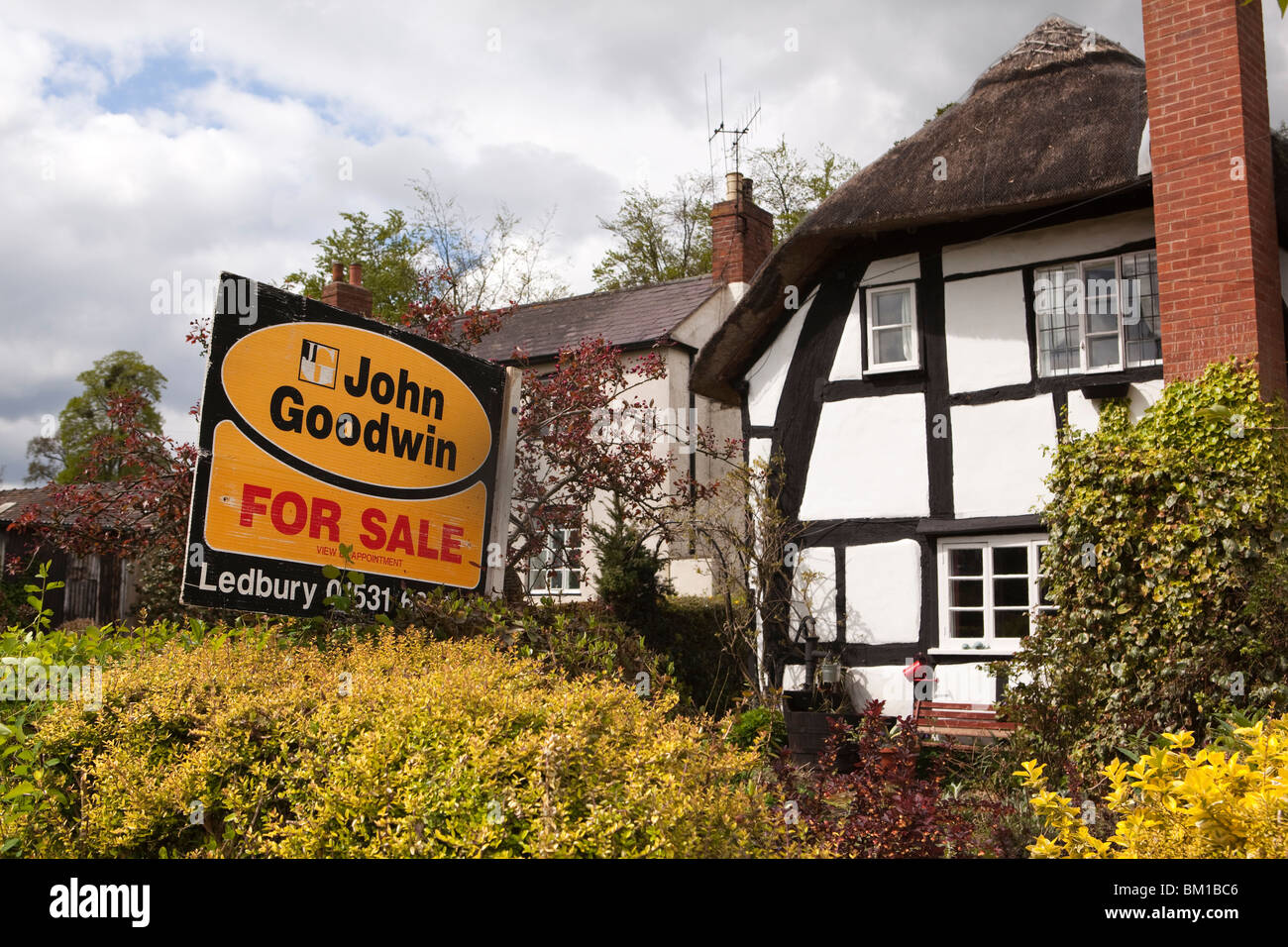 UK, England, Herefordshire, Much Marcle, idyllic half timbered thatched cottage for sale in rural village Stock Photo