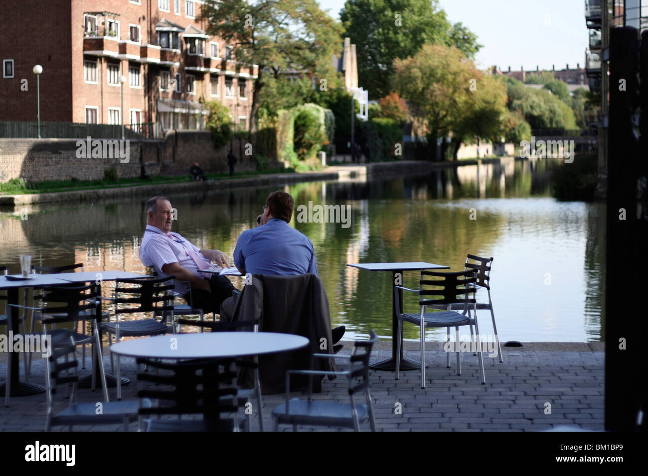 two bussiness men sat having lunch by the river/ canal in london near kings cross and camden. Stock Photo