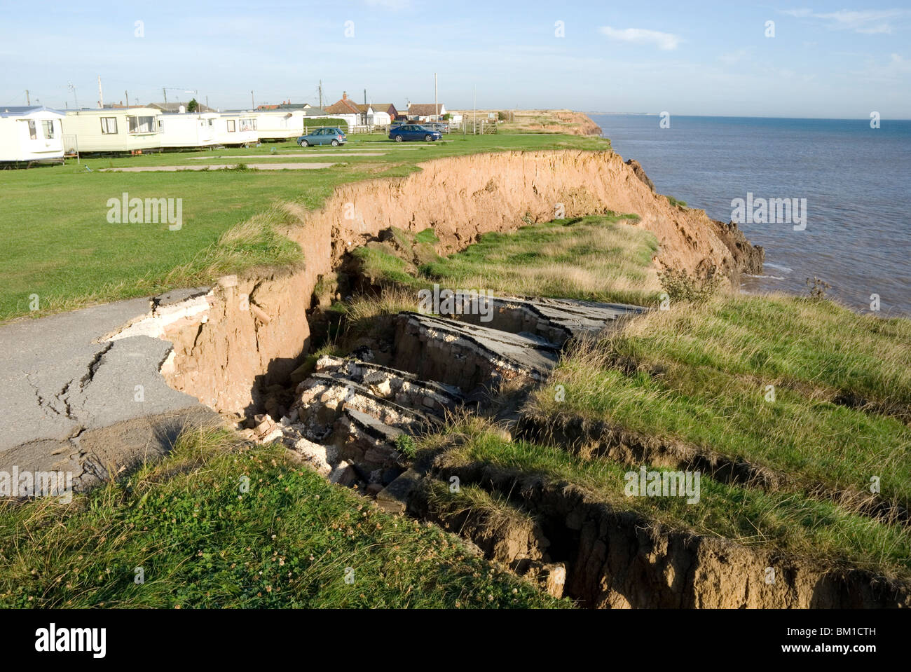 Coast erosion with active landslips in glacial till, Aldbrough, Holderness coast, Humberside, England, United Kingdom - Stock Image