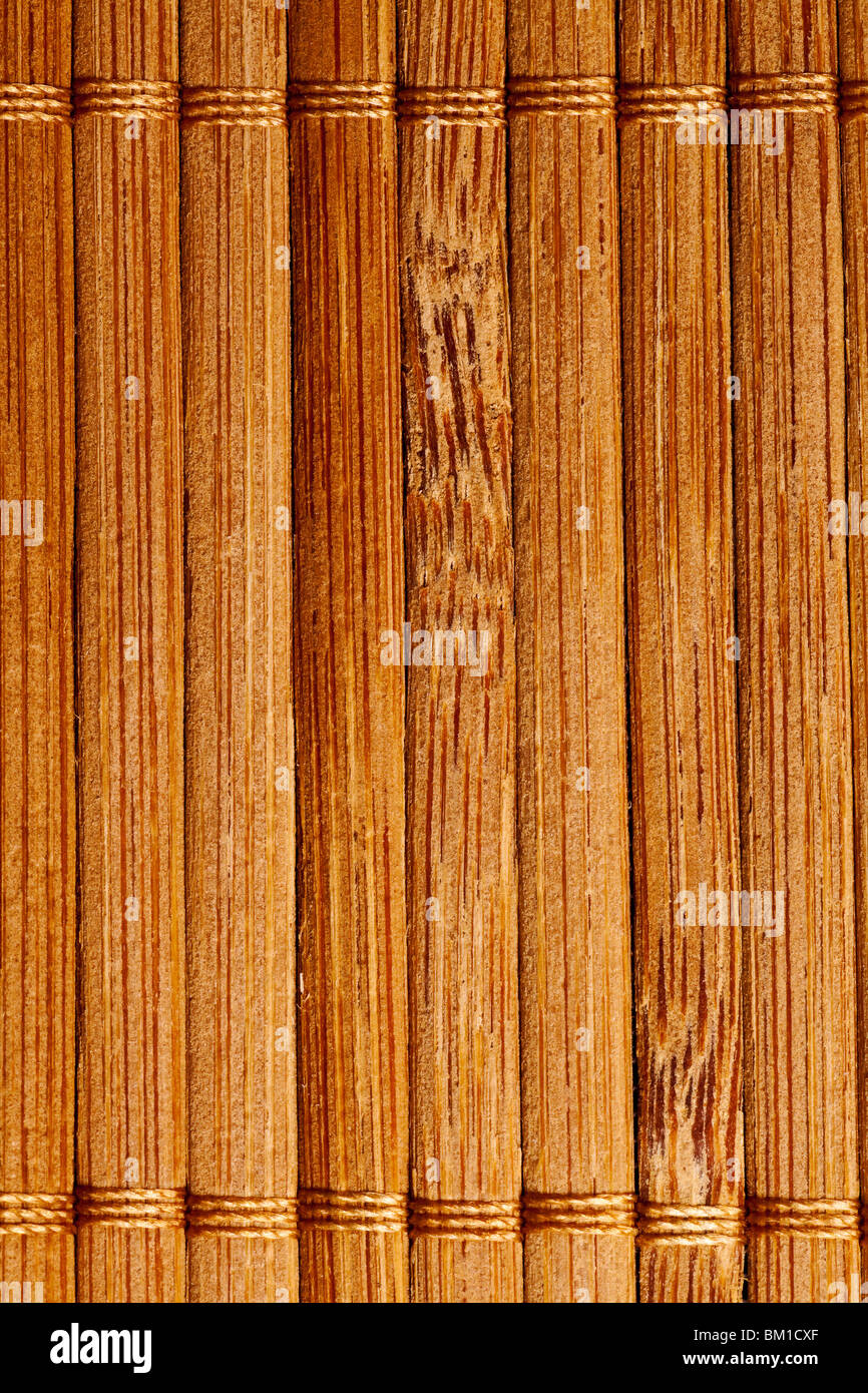 natural bamboo slatted mat background in brown tones Stock Photo