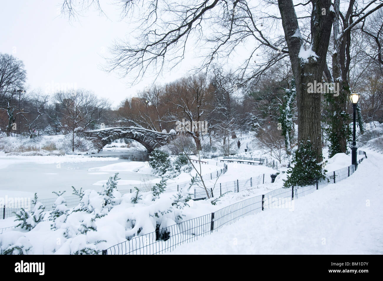 An early morning view of the Gapstow Bridge after a snowfall in Central Park, New York City, New York State, USA - Stock Image