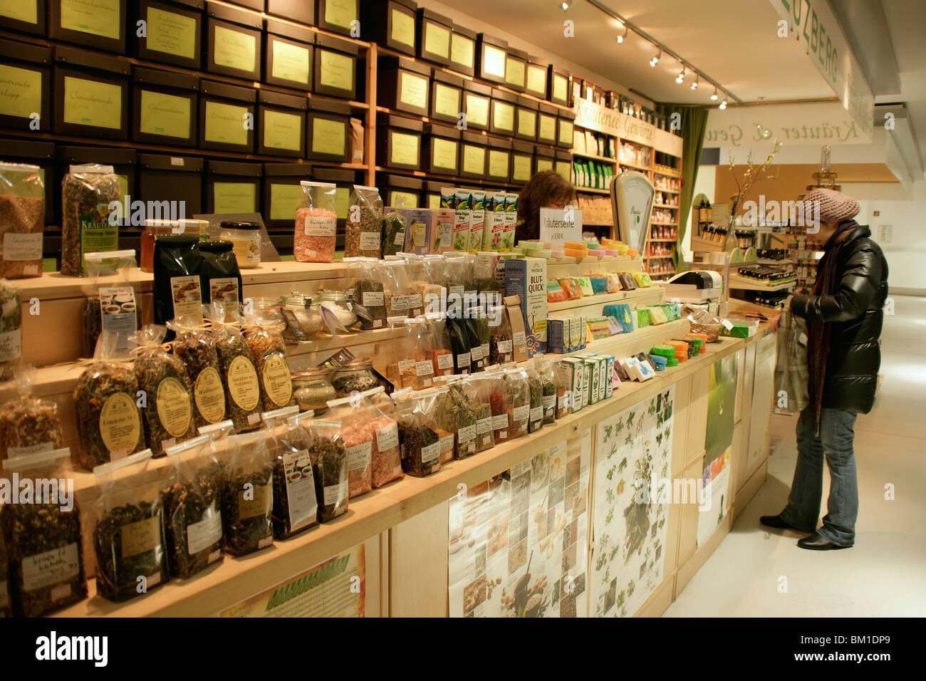 Stall selling herbs at the Marheineke Markethall in western Kreuzberg, Berlin, Germany - Stock Image