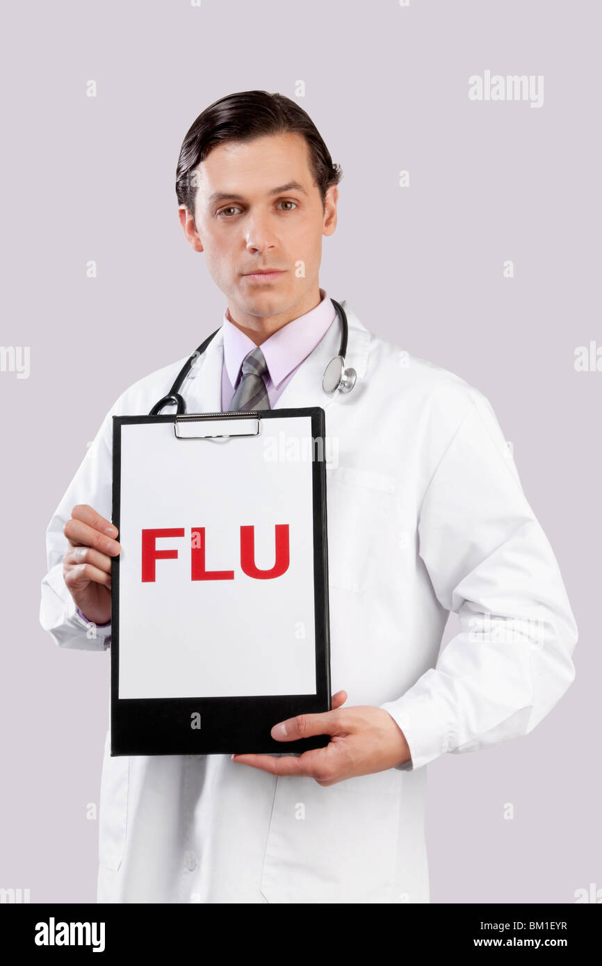 Portrait of a doctor showing FLU sign - Stock Image