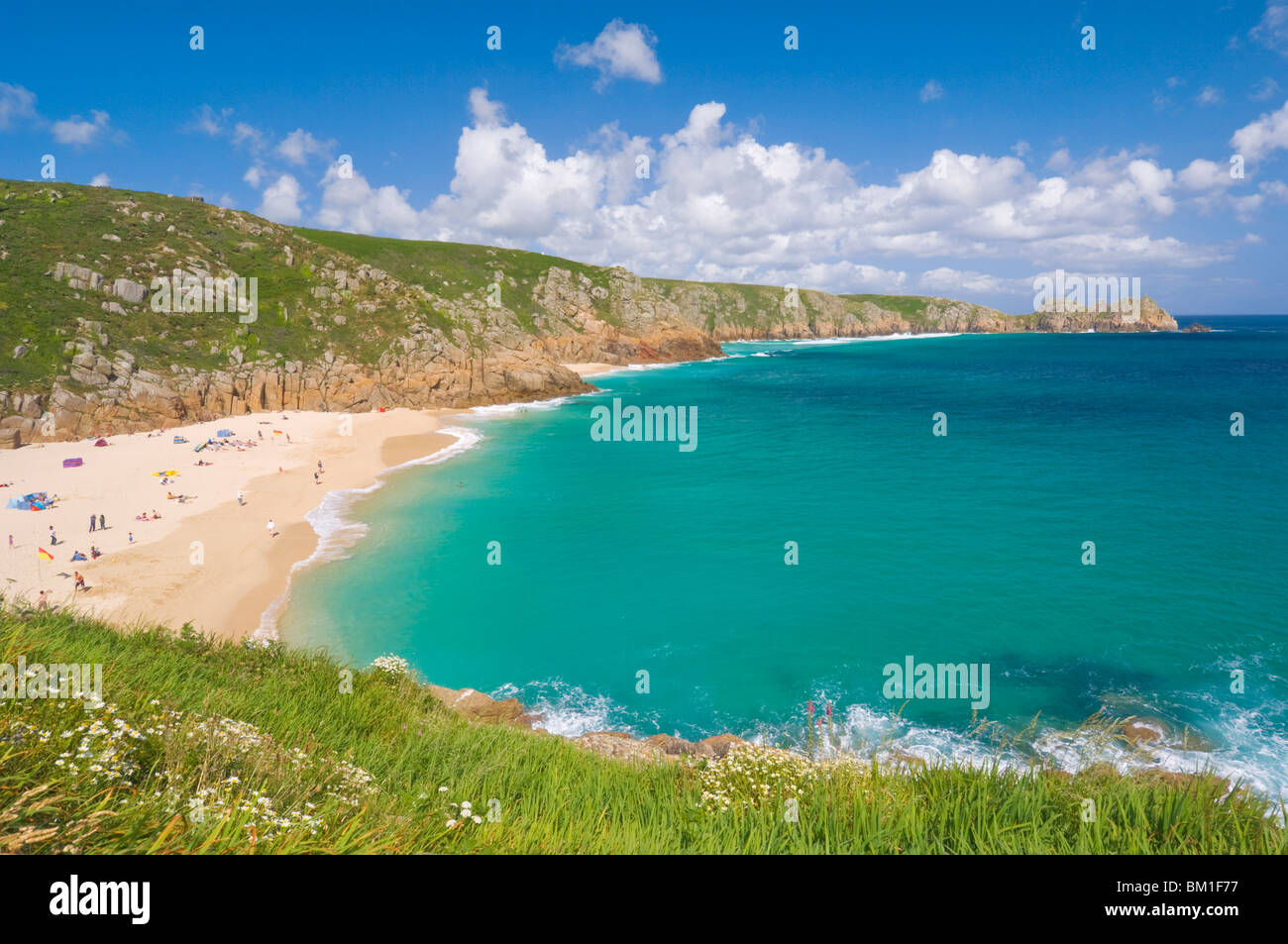 Holidaymakers and tourists sunbathing on Porthcurno beach, Cornwall, England, United Kingdom, Europe - Stock Image