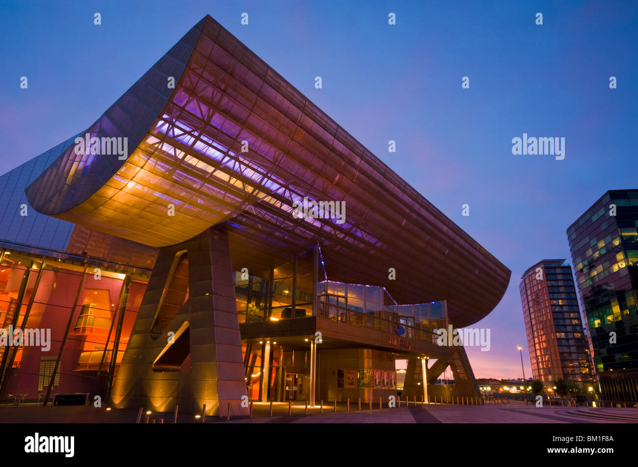 The Lowry Centre illuminated in the early evening, Salford Quays, Greater Manchester, England, United Kingdom, Europe - Stock Image