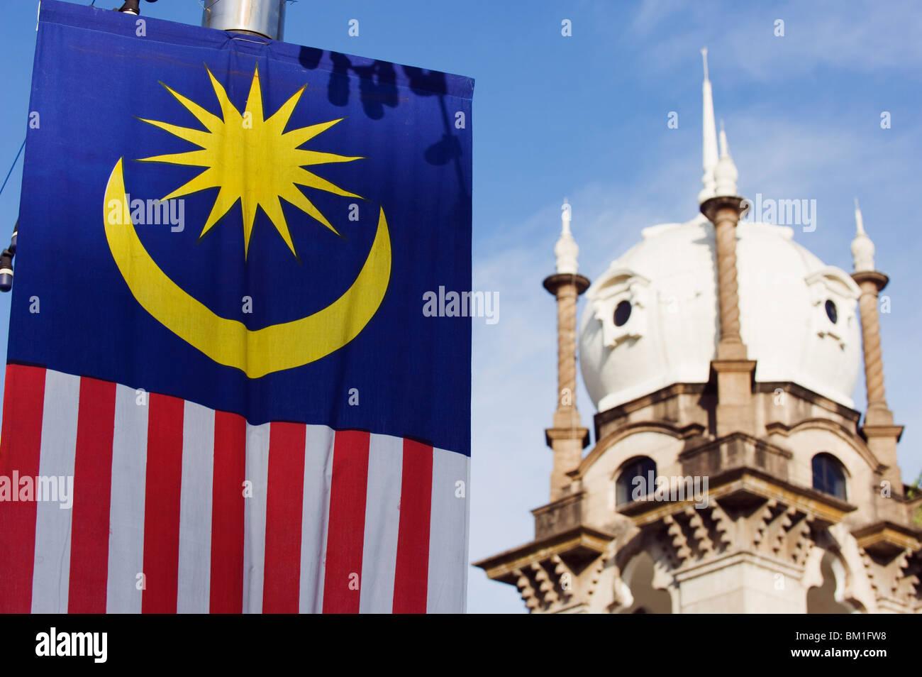 Malaysian flag and Old KL Railway Station, Kuala Lumpur, Malaysia, Southeast Asia, Asia - Stock Image