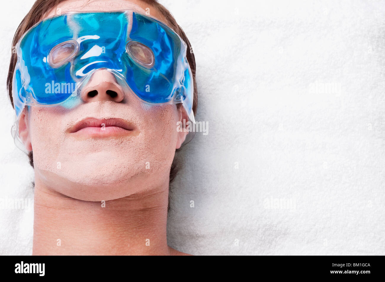 Man wearing eye mask Stock Photo