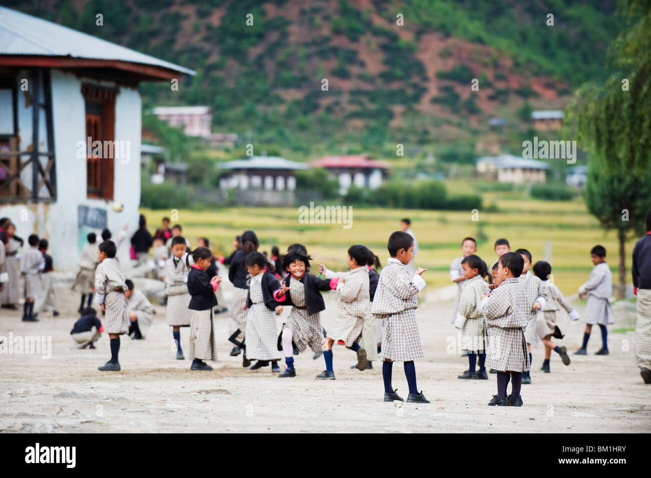 School children playing, Paro, Bhutan, Asia - Stock Image