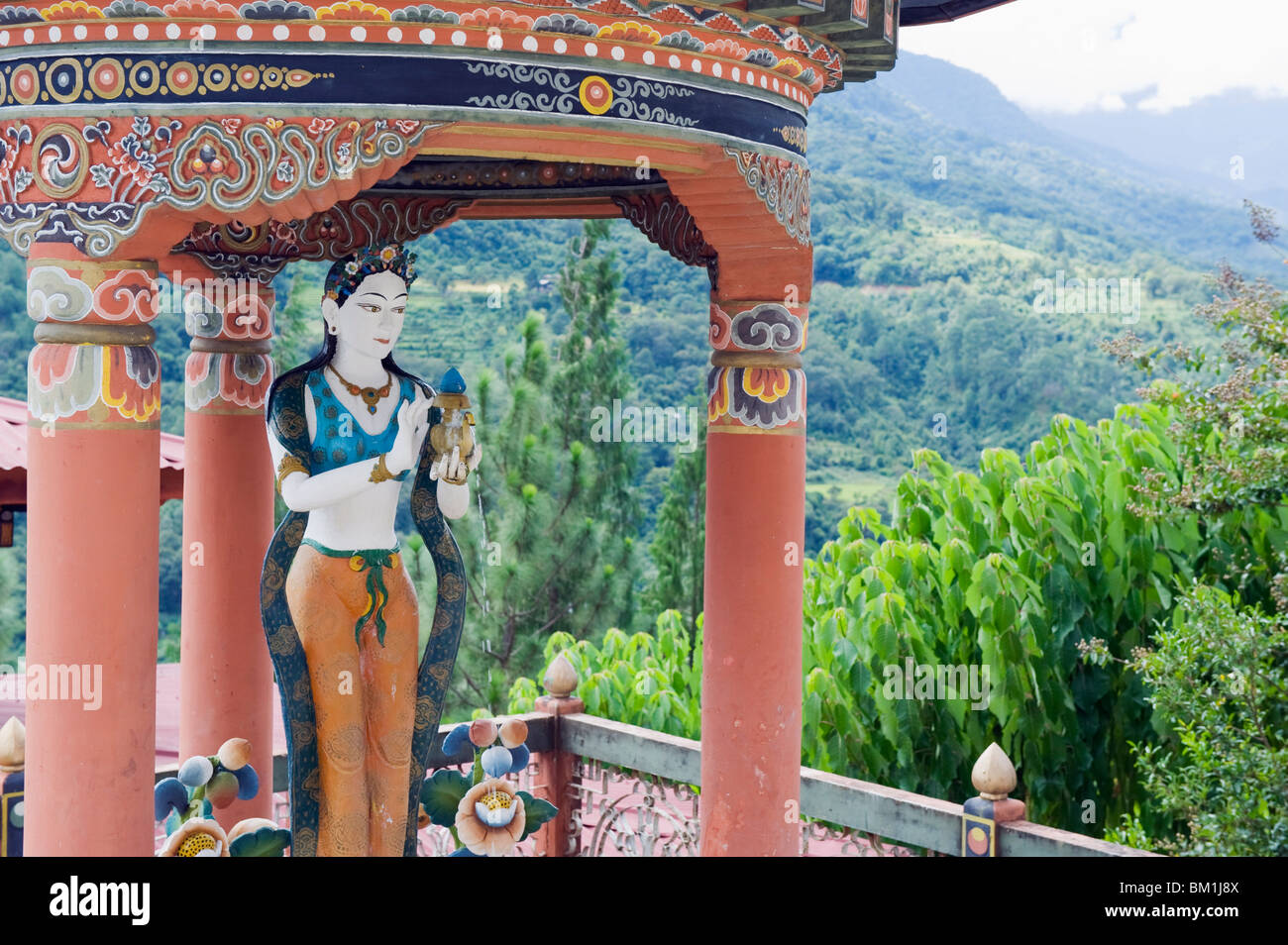 Statue at a water fountain, Khamsum Yuelley Namgyal Chorten built in 1999, Punakha, Bhutan, Asia - Stock Image