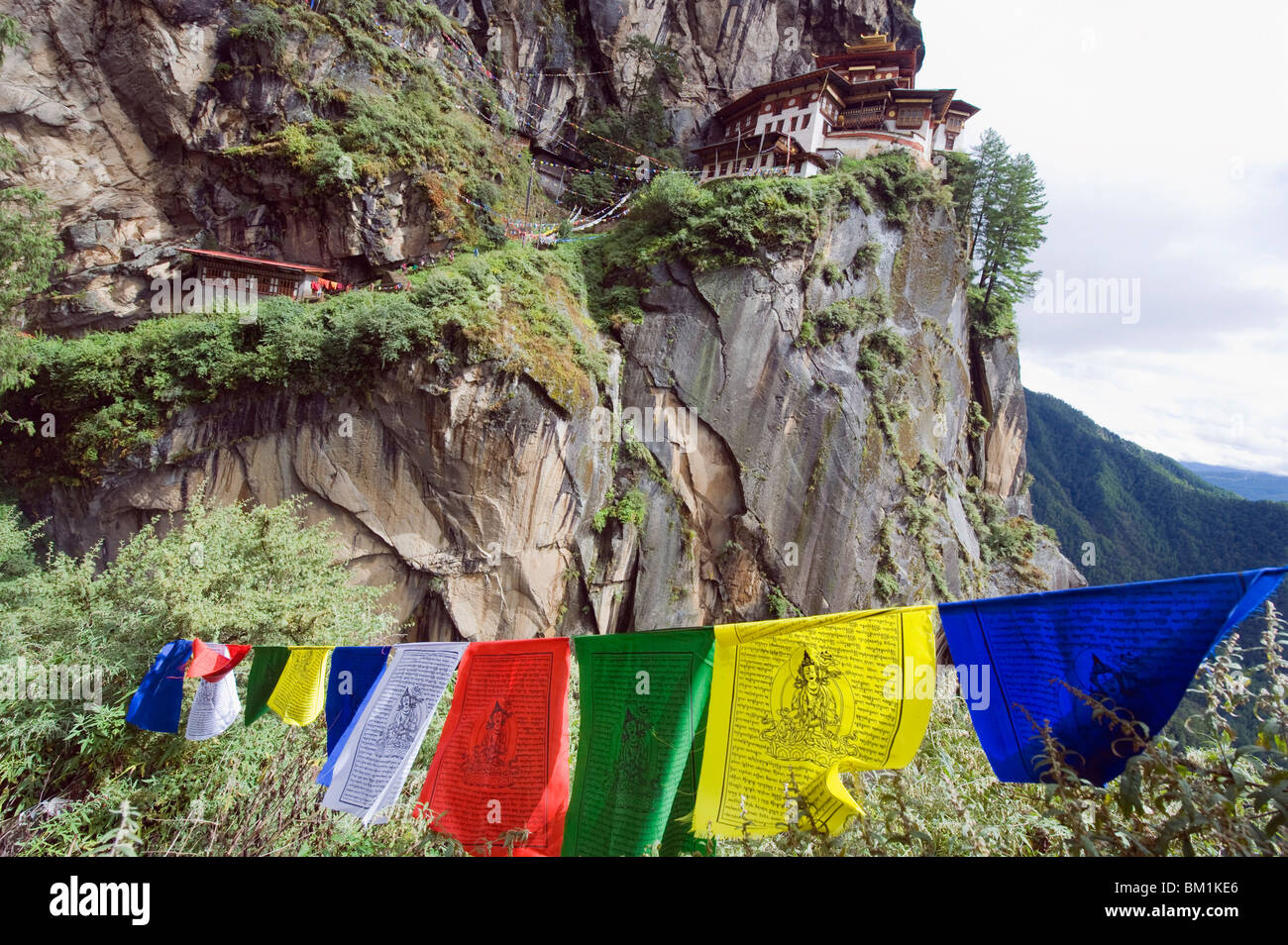 Prayer flags at the Tigers Nest (Taktsang Goemba), Paro Valley, Bhutan, Asia - Stock Image