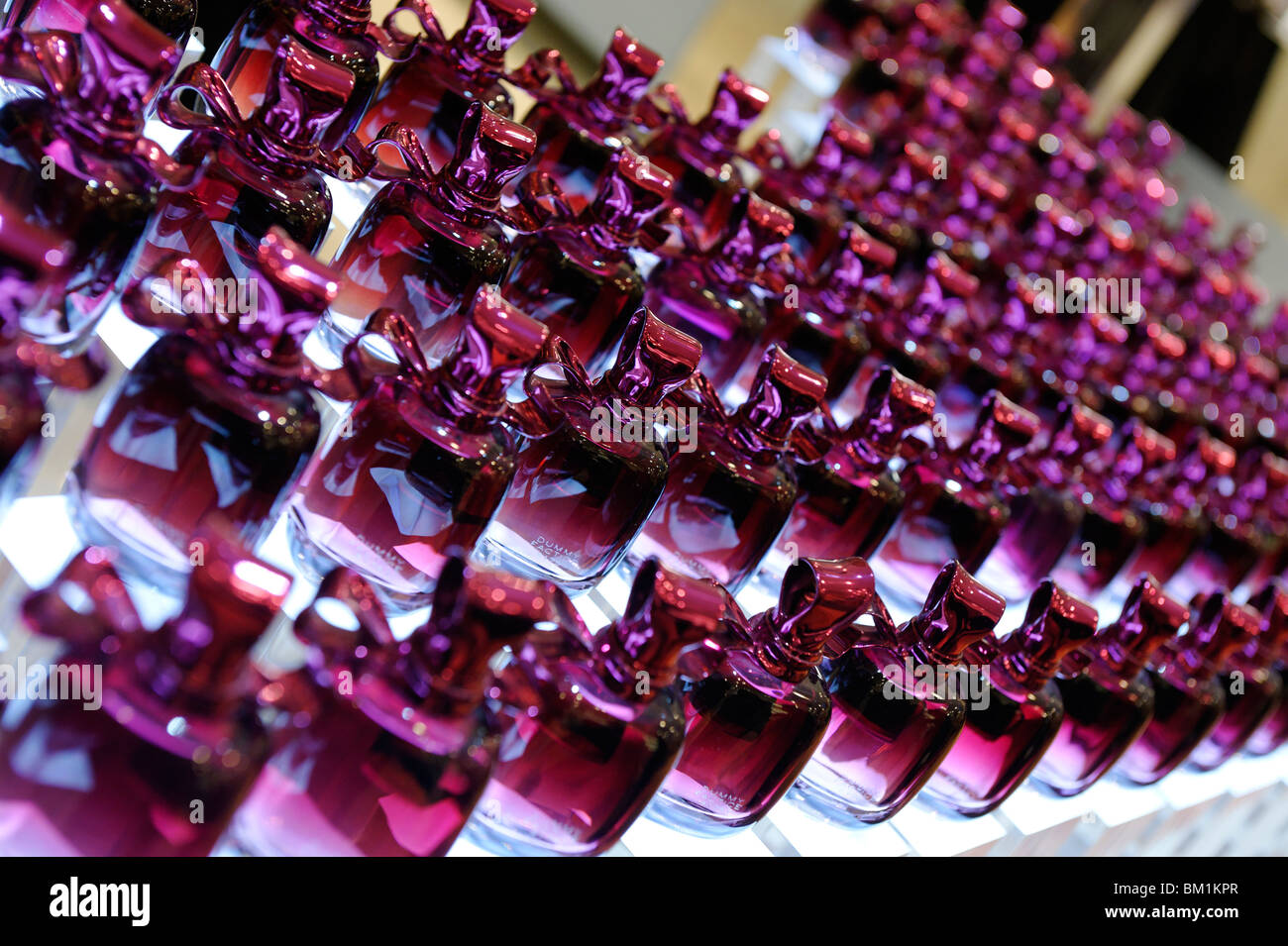 Purple perfume bottles in a row Stock Photo