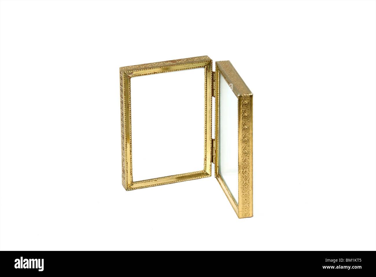 an antique bi-fold gold tone picture frame half closed Stock Photo ...