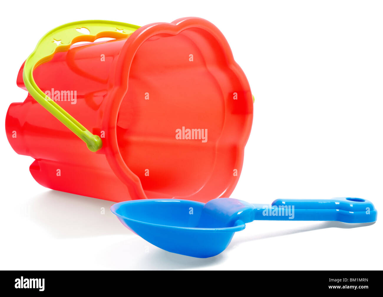 Childrens plastic bucket and spade on white background - Stock Image