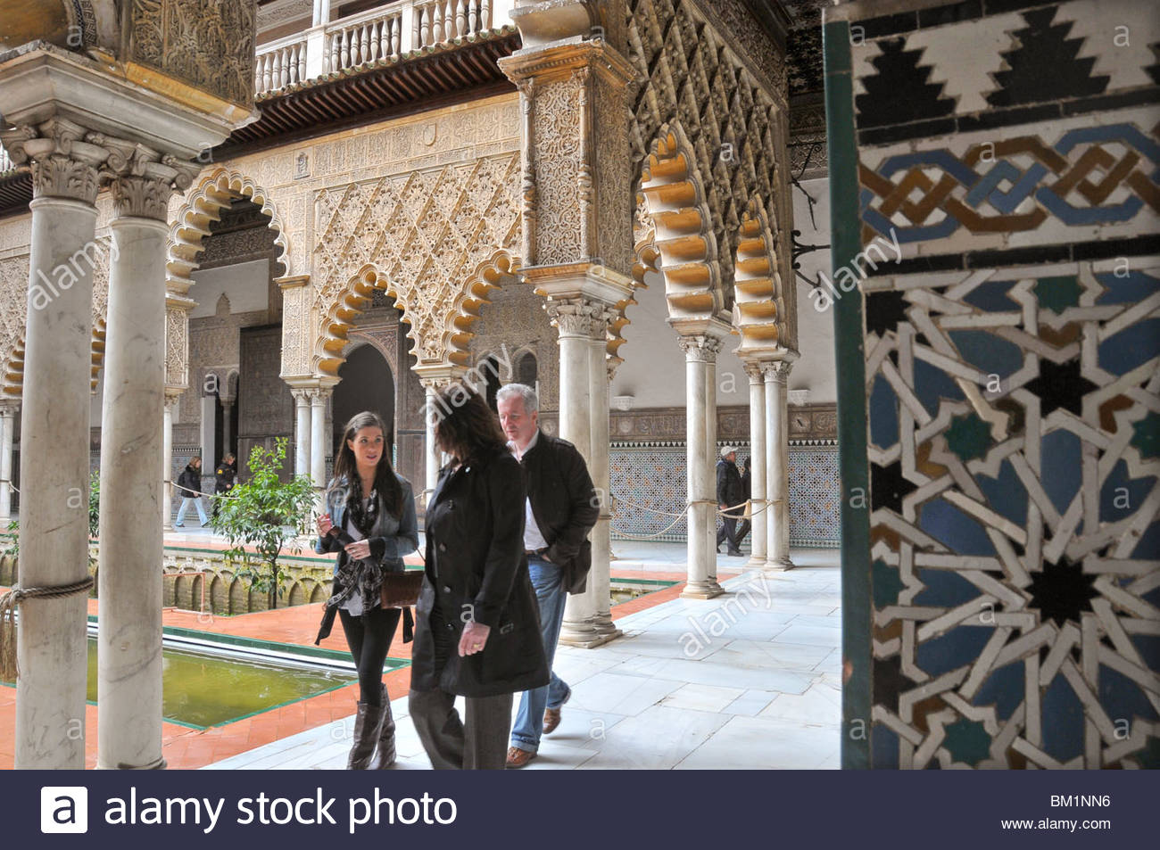 A courtyard in the Alcazar Palace in Seville (Sevilla), Andalucia, Spain - Stock Image