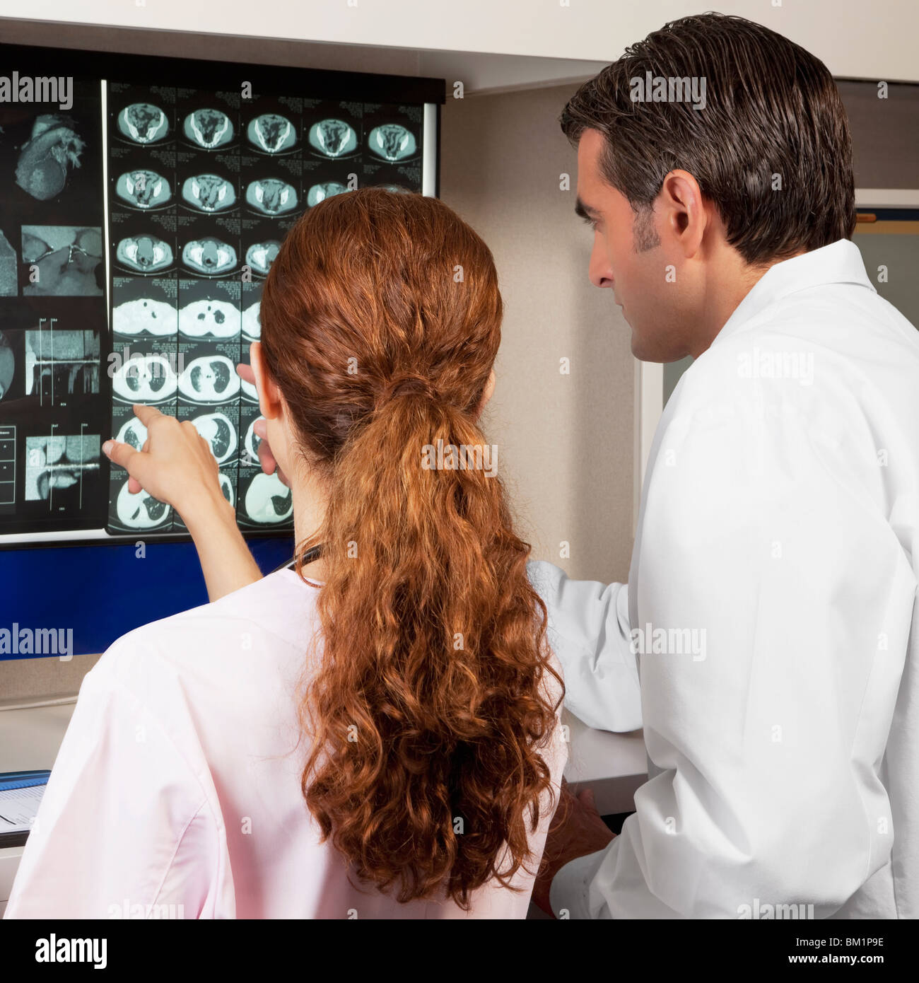 Two doctors examining MRI report Stock Photo
