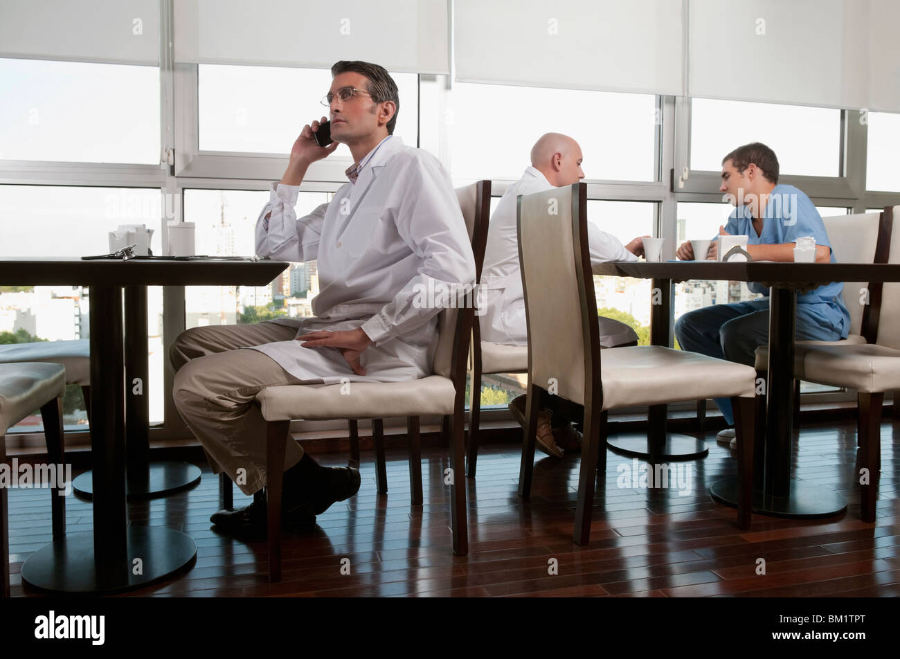 Doctors during coffee break a cafeteria - Stock Image