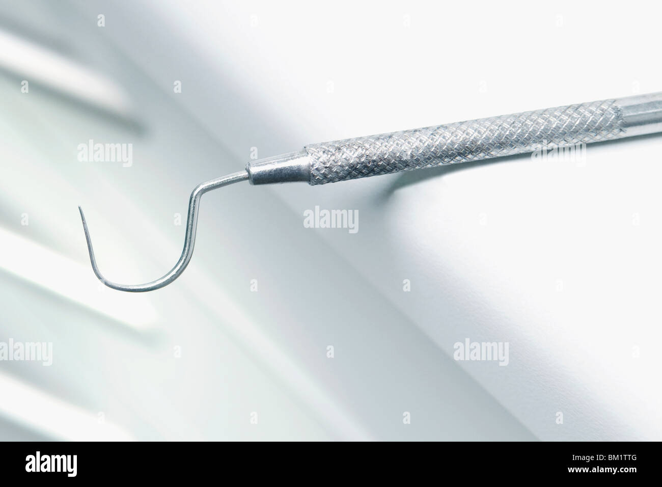 Close-up of a dental scaler in an examination room - Stock Image