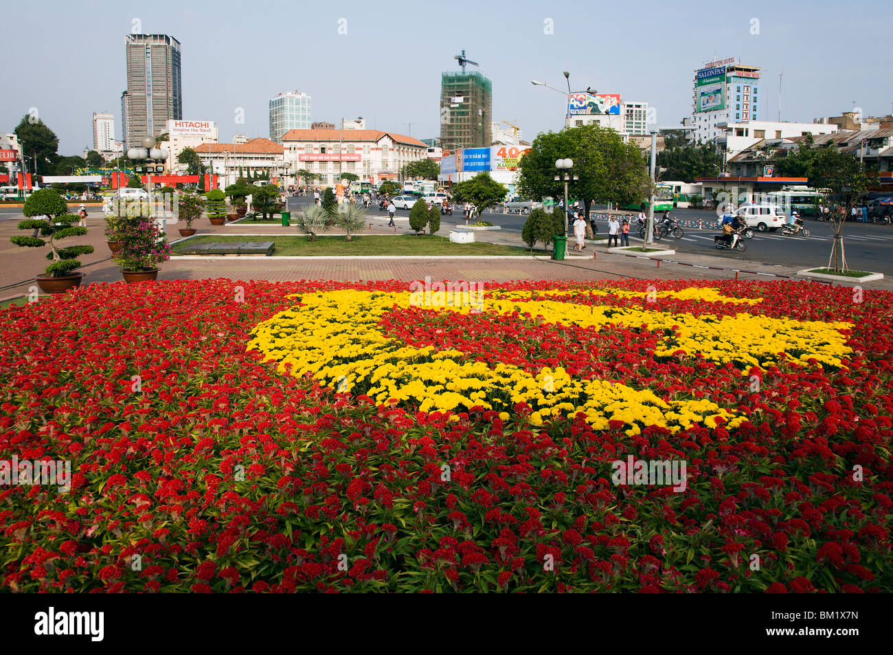 The Hammer and Sickle communist symbol as a flowerbed ath the western end of the park along Pham Ngu Lao Street. - Stock Image
