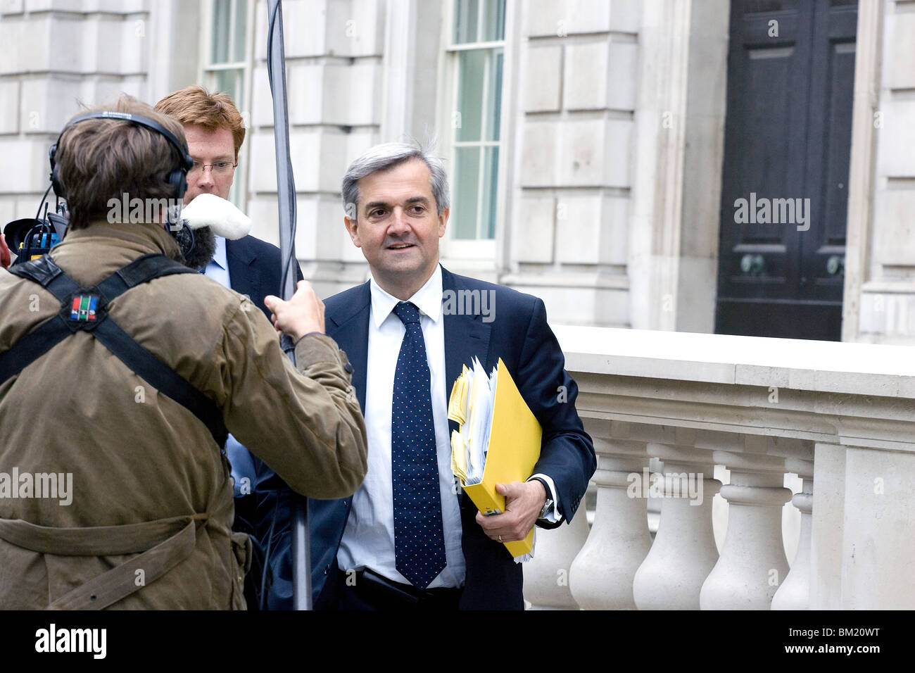 Chris Huhne on his way to the coalition talks with the Conservatives after the 2010 election. - Stock Image
