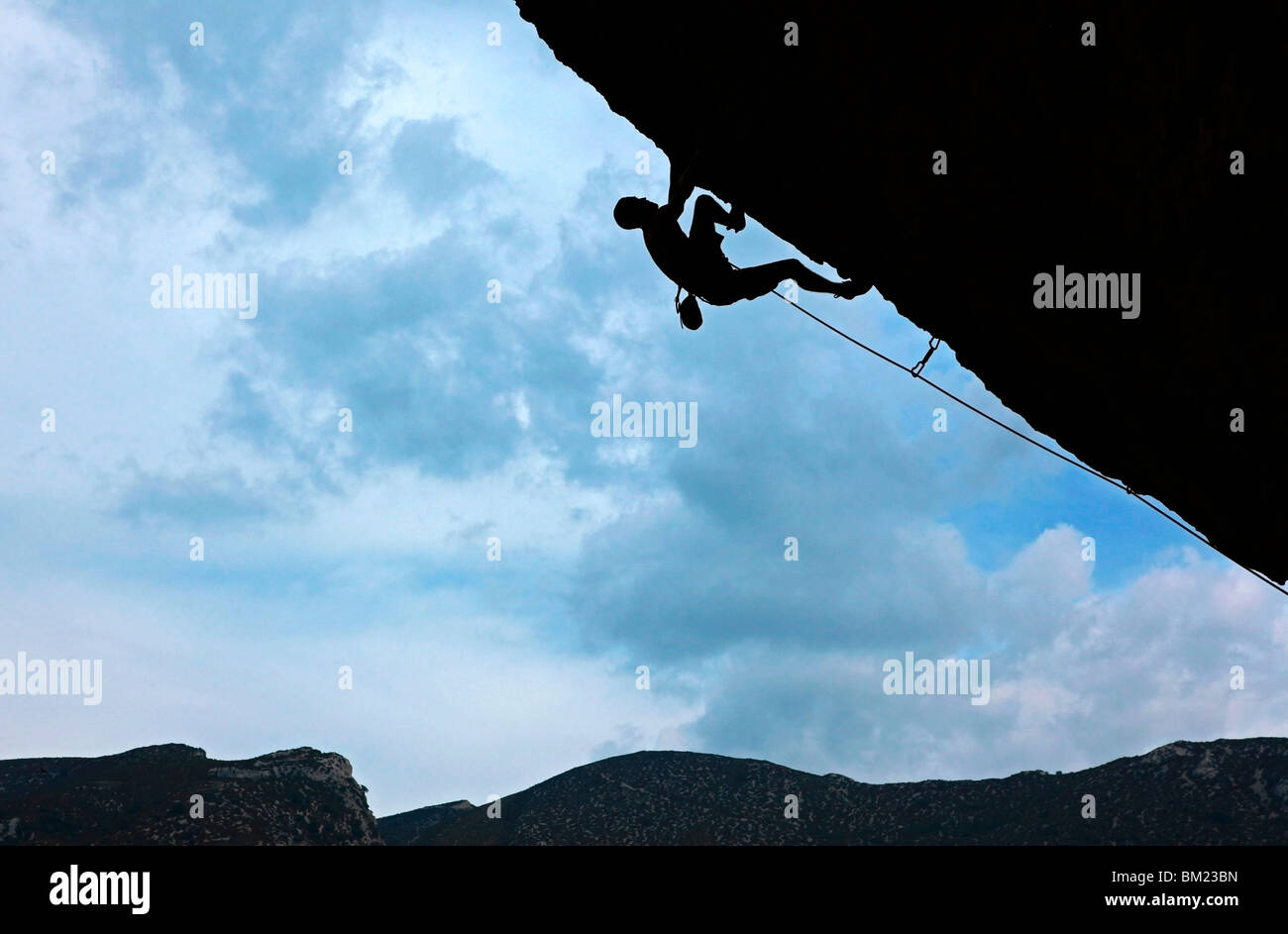 A climber tackles a severely overhanging route in the caves of the Mascun Gorge, Sierra de Guara mountains, Aragon, - Stock Image