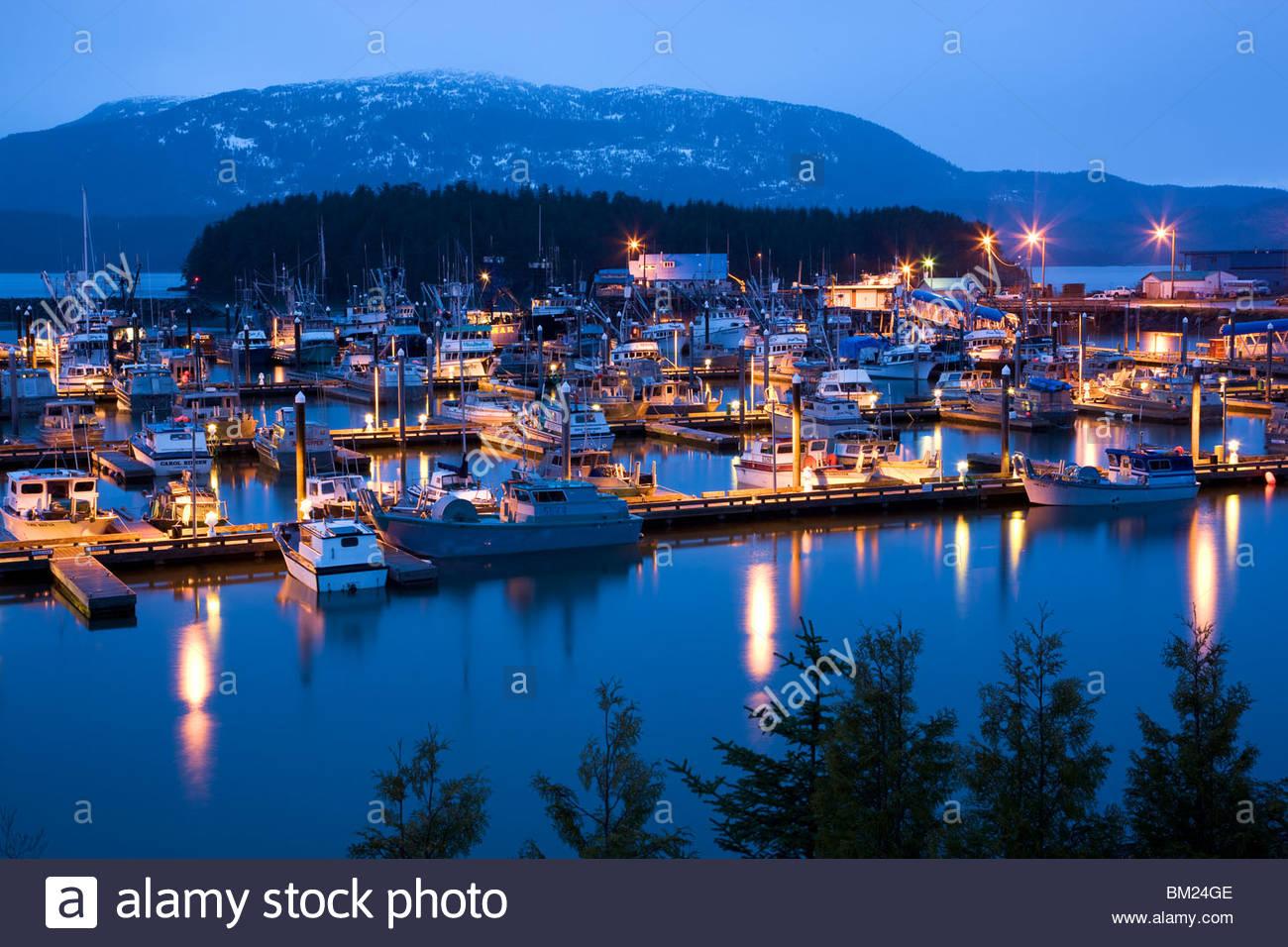 Boat Harbor at night during a rain strom, Cordova, Alaska. - Stock Image