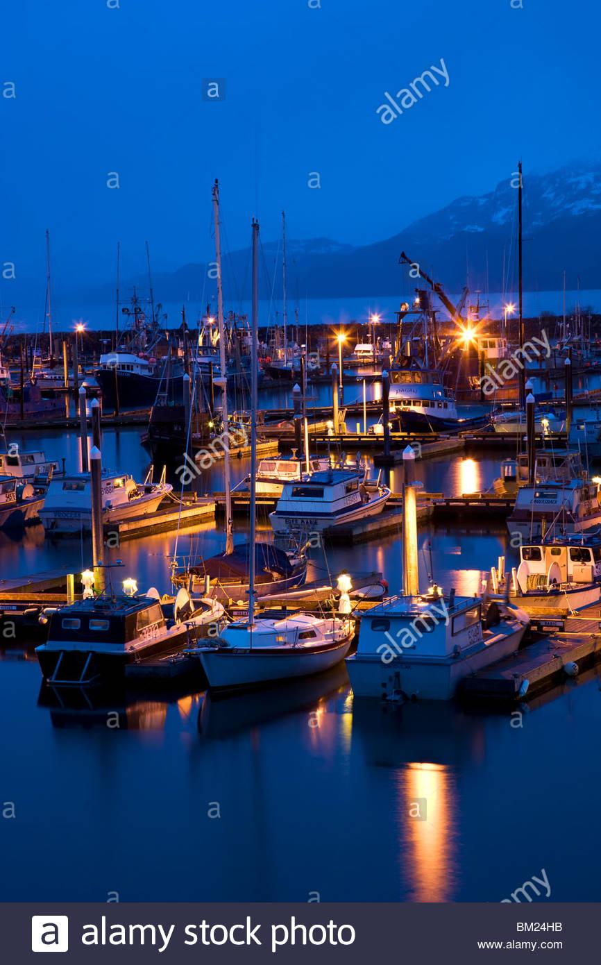 Boat Harbor at night during a rain storm, Cordova, Alaska. - Stock Image