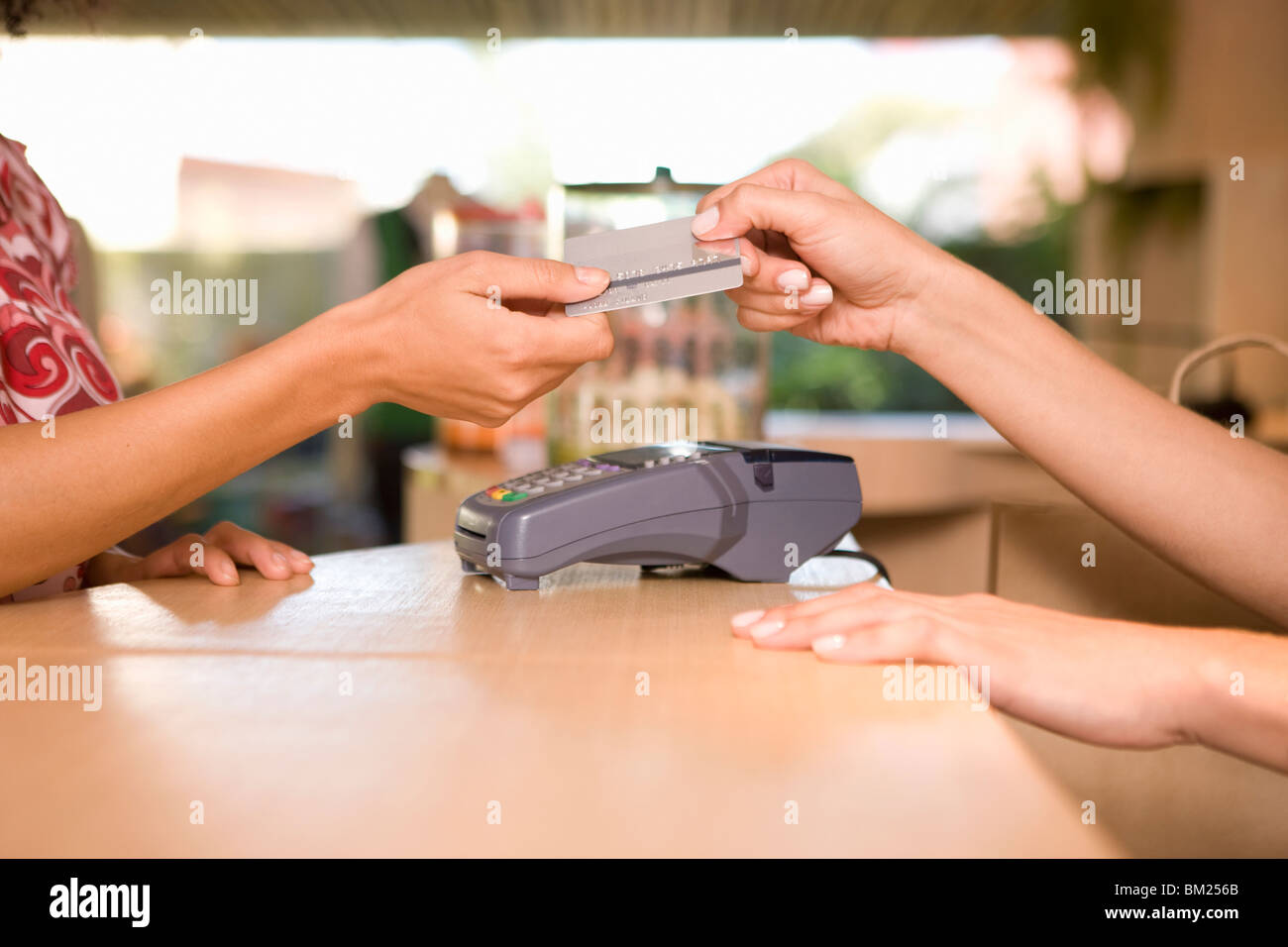 Woman Paying Through Credit Card At The Checkout Counter In A Stock