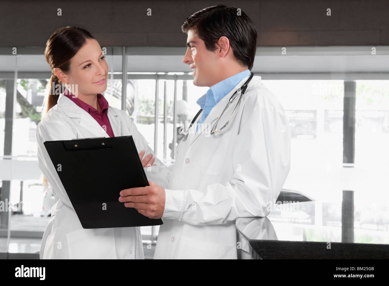 Two doctors talking in a hospital - Stock Image