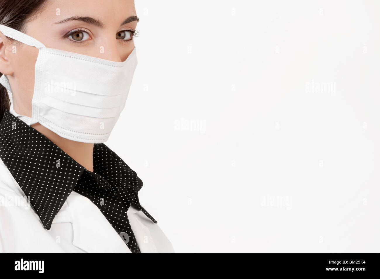 Female doctor wearing a flu mask - Stock Image