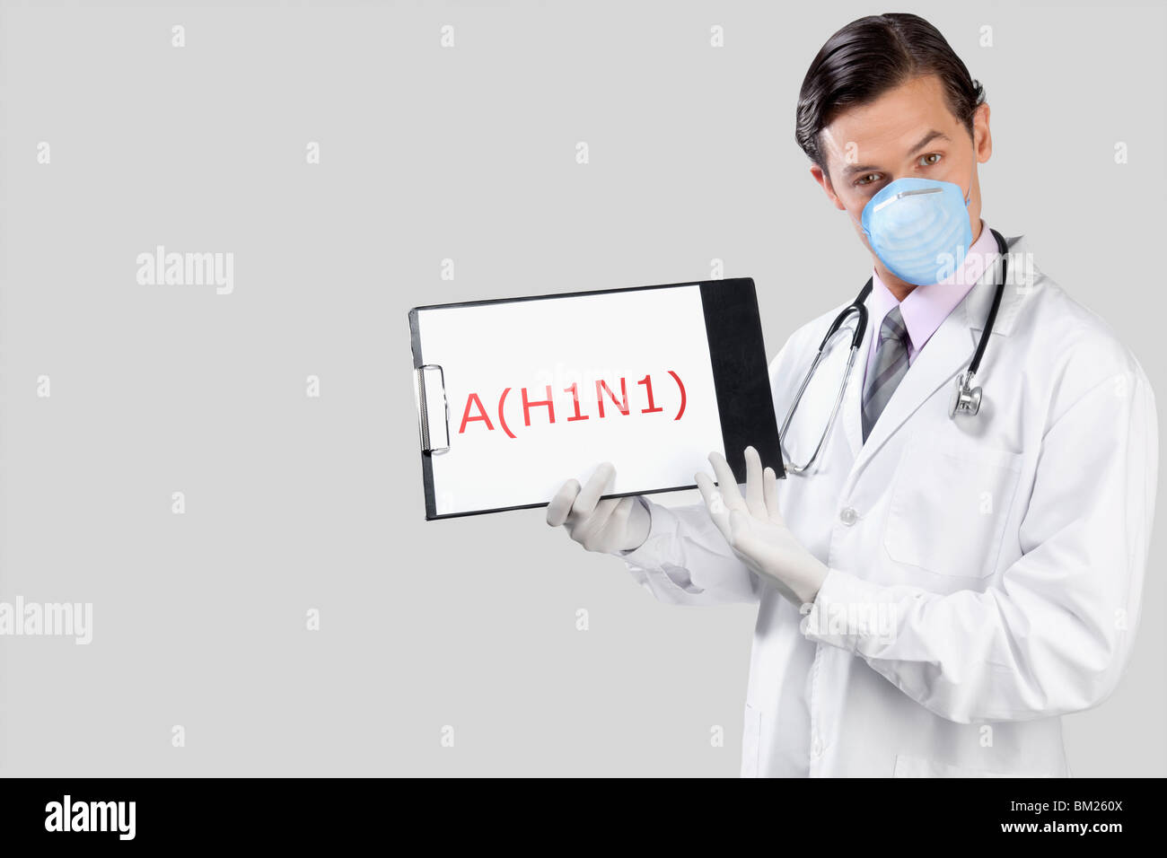 Portrait of a doctor showing H1N1 sign - Stock Image