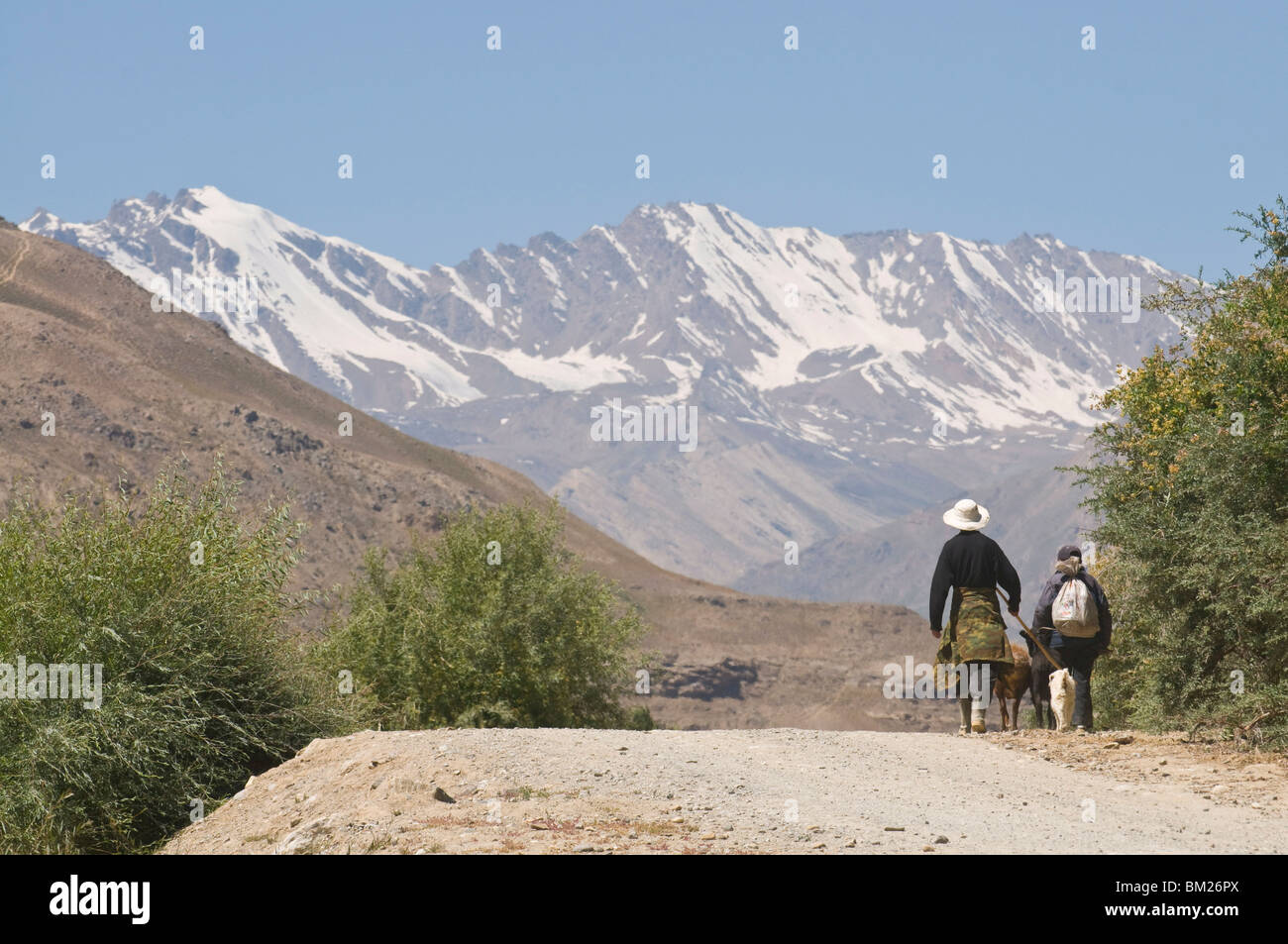 Farmers on their way home, Shokh Dara valley, the Pamirs, Tajikistan, Central Asia - Stock Image
