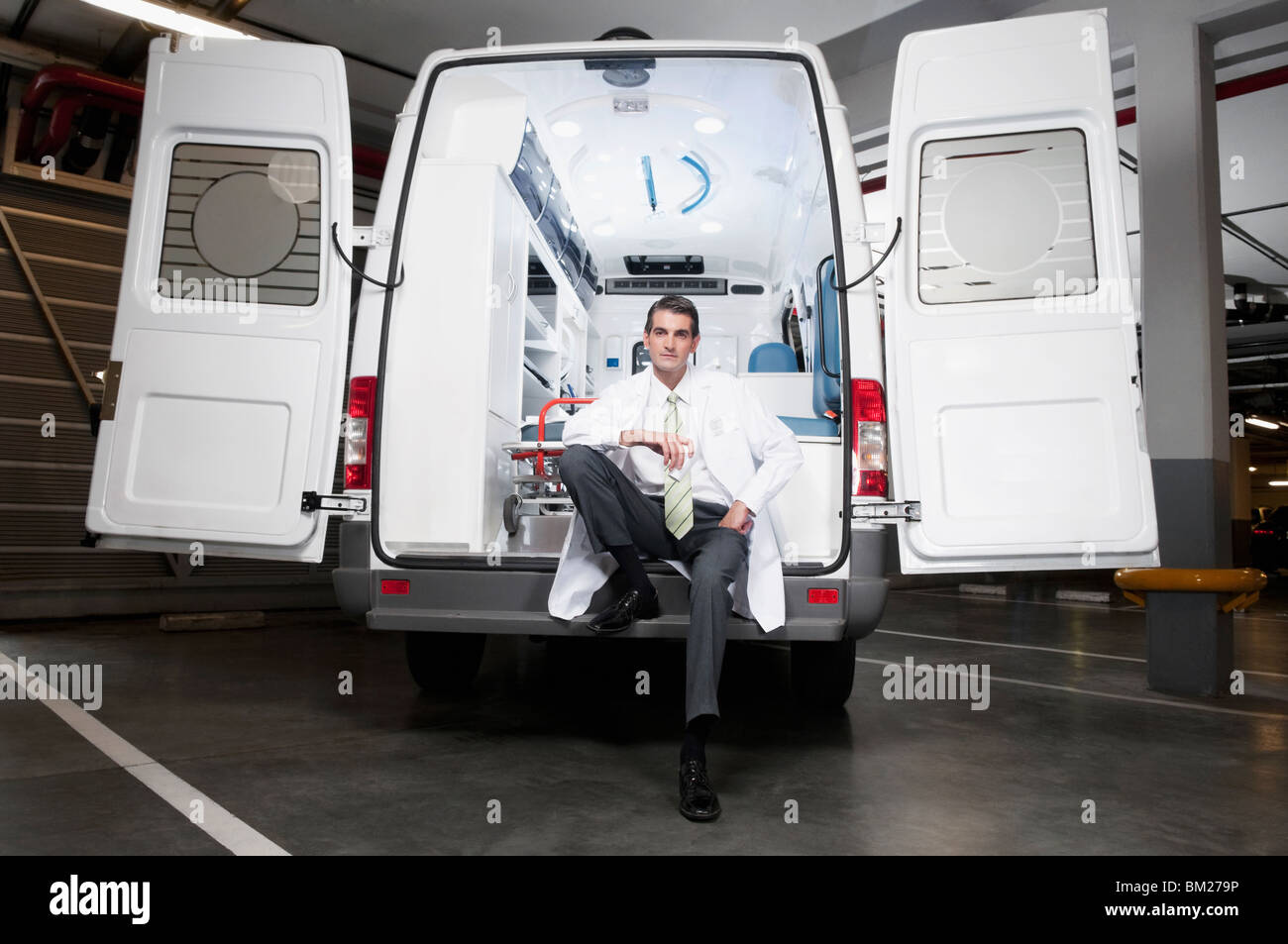 Doctor sitting in an ambulance - Stock Image