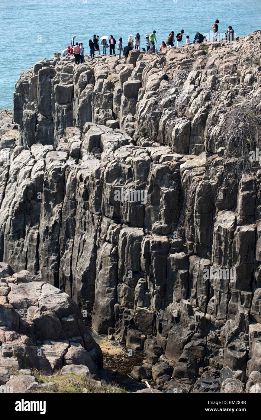 The rugged basaltic cliffs called Tojimbo in Sakai on the Sea of Japan coast, a popular tourist attraction, Fukui, - Stock Image
